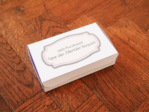 Box mit Etikett für das Spiel Tiere der Zillertaler Bergwelt